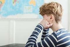 Bored Boy Sitting at Desk Head in Hands Royalty Free Stock Images