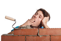 Bored bricklayer yawning Royalty Free Stock Image