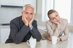 Bored business couple having coffee before work in morning Stock Photo