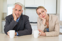 Bored business couple having coffee before work in morning Stock Images