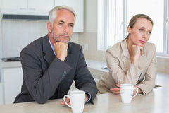 Bored business couple having coffee before work in morning Royalty Free Stock Images