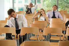 bored Business executives sitting in conference room Royalty Free Stock Image