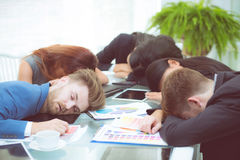 Bored business people sleeping in a meeting colleague. The bored business people sleeping in a meeting colleague Royalty Free Stock Image