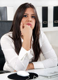 Bored business woman. A beautiful bored brunette business woman Royalty Free Stock Photo