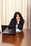 Bored business woman browse on laptop. In her office Royalty Free Stock Photography