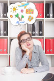 Bored business woman dreaming about holiday. Overwork concept Stock Images