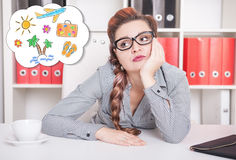 Bored business woman dreaming about holiday. Overwork concept Royalty Free Stock Photography