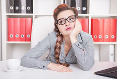 Bored business woman. Overwork concept. Bored business woman working in office. Overwork concept Stock Image