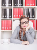 Bored business woman working in office Royalty Free Stock Images