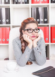 Bored business woman working in office Stock Photography