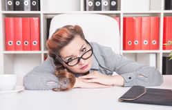 Bored business woman working in office Royalty Free Stock Photography