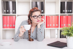 Bored business woman working. Overwork concept. Bored business woman working in office. Overwork concept Stock Images