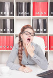 Bored business woman yawning in office Stock Images