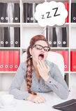 Bored business woman yawning. Overwork concept Stock Photo