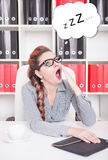 Bored business woman yawning. Overwork concept Royalty Free Stock Image