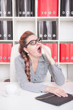 Bored business woman yawning. Overwork concept. Bored business woman yawning in office. Overwork concept Royalty Free Stock Photo
