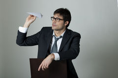 Bored businessman. With paper plane Stock Image