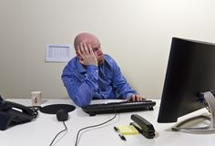 Bored Businessman. / office worker in his office stock photography