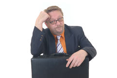 Bored businessman. Middle aged bored businessman awaiting, formal dressed, studio shot Stock Photography