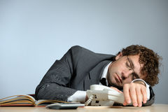 Bored businessman. Horizontal image of bored young businessman Stock Images