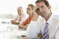 Bored Businessman Looking Away At Conference Table stock photography