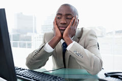 Bored businessman looking at his computer Stock Images