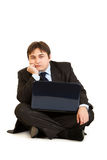 Bored businessman sitting on floor with laptop Royalty Free Stock Photo
