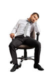 Bored businessman sitting on the office chair Stock Photos