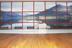 Bored Businessman Using Laptop In Modern Conference Room Royalty Free Stock Photo