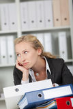 Bored Businesswoman With Binders Stock Photo
