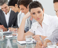Bored businesswoman at a presentation Stock Image