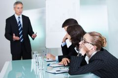 Bored businesswoman sleeping in a meeting Royalty Free Stock Photos