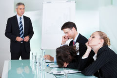 Bored businesswoman sleeping in a meeting Stock Image