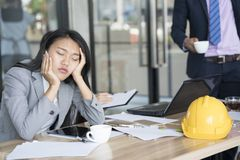 Bored businesswoman taking a nap in conference meeting room stock photos