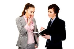 Bored businesswoman talking with her partner. Stock Photos