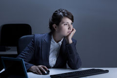 Bored businesswoman using computer royalty free stock photos