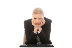 Bored businesswoman working on pc Royalty Free Stock Photo