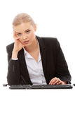 Bored businesswoman working on pc Stock Photos
