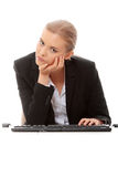 Bored businesswoman working on pc Royalty Free Stock Photos