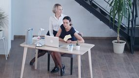 Bored businesswomen looking away while sitting on chair. Professional shot in 4K resolution. 091. You can use it e.g. in your commercial video, business stock video footage