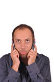 Bored busy guy with two cellphones Stock Photos