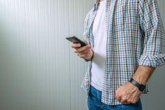 Bored casual man using mobile phone Stock Photo