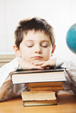 Bored caucasian boy in classroom Stock Images