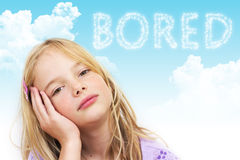 Bored child. A bored little girl with her head in her hand Stock Photography