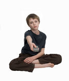 Bored child. A bored sad looking child with remote stock images