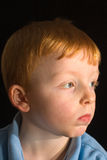 Bored child. Boy looking like hes in a bad mood or bored Stock Images