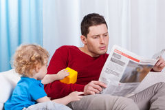 Bored child looking at father Royalty Free Stock Image