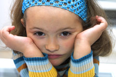 Bored child portrait. Closeup of a bored girl looking at the camera Royalty Free Stock Photo