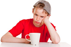 Bored child with white cup Royalty Free Stock Photos