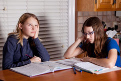 Bored children doing homework Royalty Free Stock Image